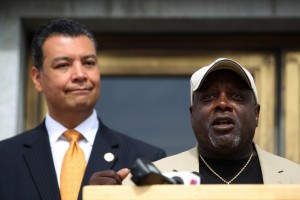 Dorsey Nunn, executive director of the Legal Services for Prisoners with Children, speaks as California Secretary of State Alex Padilla looks on during a news conference at the Rene C. Davidson Courthouse in Oakland on Aug. 4, 2015. (Anda Chu/Bay Area News Group)