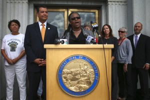 Alameda County Chief Probation Officer LaDonna M. Harris speaks as California Secretary of State Alex Padilla, second from left, looks on during a news conference at the Rene C. Davidson Courthouse in Oakland, Calif., on Tuesday, Aug. 4, 2015. Padilla announced on Tuesday that he's dropping the appeal of Scott v. Bowen, clearing the way for 45,000 Californians who have been convicted of low-level felonies to get the right to vote. (Anda Chu/Bay Area News Group)
